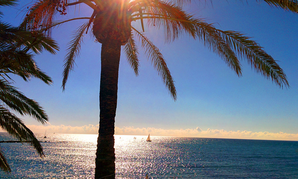 things to see and do in Marbella - Gaze on passing boats from the seafront promenade